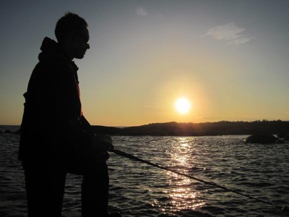 jekfiske i solnedgång